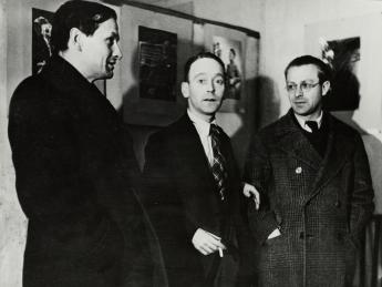 John Heartfield, Gustav Regler and Tristan Tzara at the Heartfield exhibition, Paris,1935. photo: Akademie der Künste, Berlin, JHA 607/23.4.1.